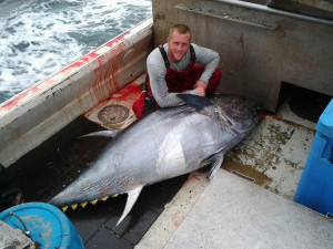 Devon Higgins, who worked as a commercial fisherman for many years, is pictured here with a tuna in 2013.