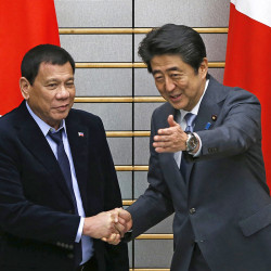 Philippine President Rodrigo Duterte, left, is greeted by Japan's Prime Minister Shinzo Abe at the start of their meeting in Tokyo Wednesday Associated Press/ssei Kato via Associated Press