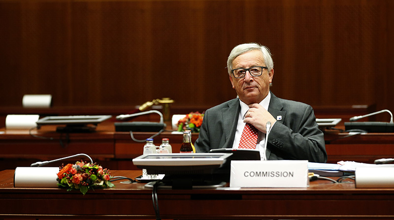 European Commission President Jean-Claude Juncker adjusts his tie as he sits in his seat prior to the start of a round table session during the EU Summit in Brussels, Friday, Oct. 21, 2016. (AP Photo/Alastair Grant)